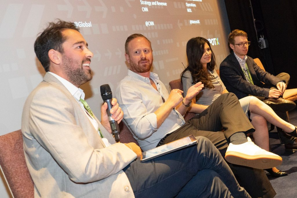 Rob Bradley from CNN, Aseel Almolliyeh from Global, and Adam Leslie from Metro.co.uk with panel moderator Ed Wale from SpotX at the #breakfastXchange event in London